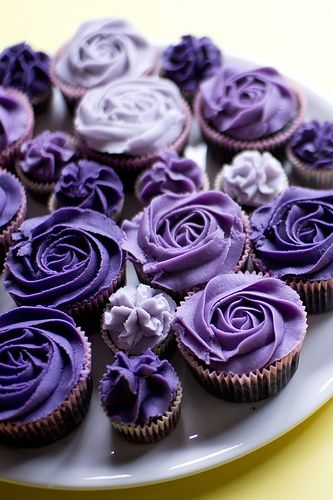 purple ombre rose cupcakes {variation of colors and mini mixed in with regular size is cute, would do pinks instead of purples}.