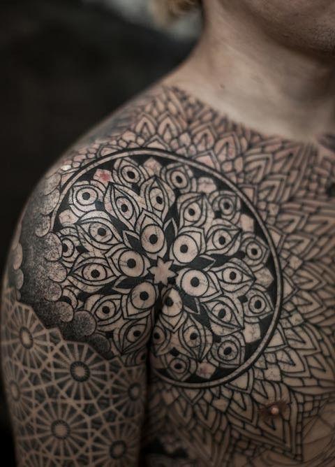 circular shoulder patterned tattoo