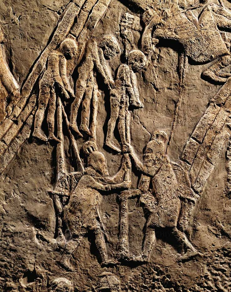 Assyrian warriors empaling Jewish prisoners after conquering the Jewish fortress Lachish (battle 701 BCE). Part of a relief from the palace of Sennacherib at Niniveh, Mesopotamia (Iraq)  British Museum