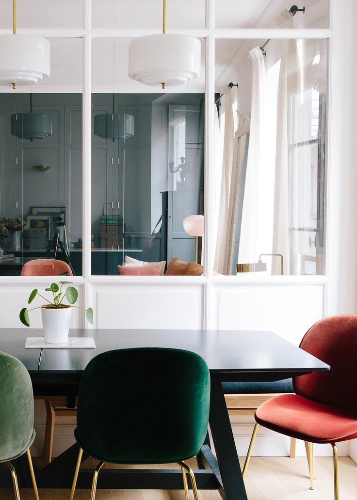 a mix of velvet chairs in the dining room | a happy chic parisian apartment tour via coco kelley