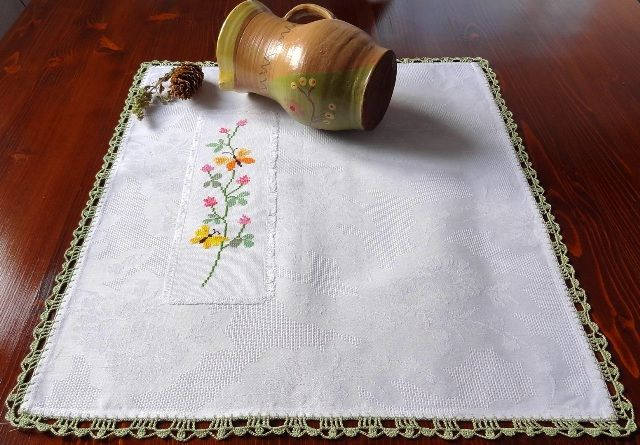Placemat with crocheted border and sewed motif