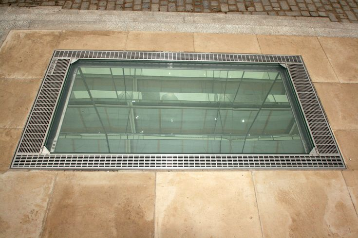 Heliobus Mirror Shaft cover bringing daylight, ventilation and outside views to basements.