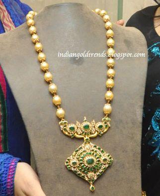 Latest Indian Gold and Diamond Jewellery Designs: Beautiful Gold South sea pearrl long with designer emerald uncut diamond pendant
