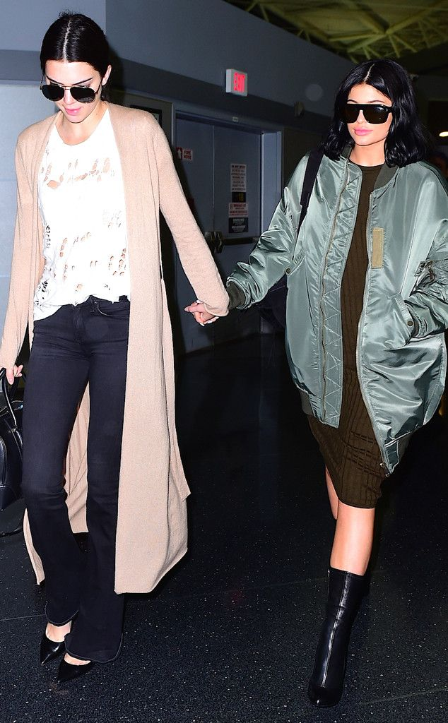 The Jenner sisters look chic as they make their way through the airport.