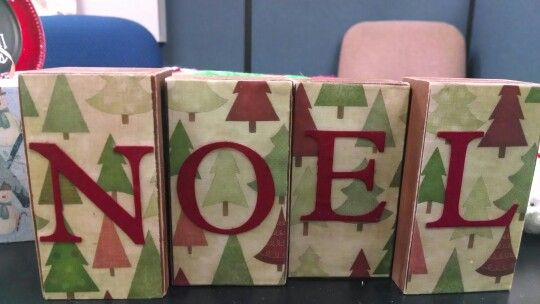 Noel painted wooden blocks and modge podged with scrapbook paper and letters cut by cricut.