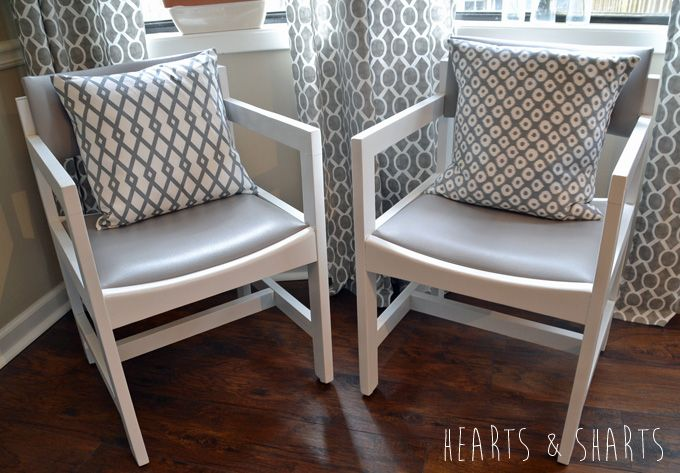 Kitchen-Chairs-Makeover--www.heartsandsharts.com - WOW! These chairs used to be horrible. I like the idea of the grey vinyl - she changed the vinyl and spray paint them white (and made some cute pillows to sit on them).