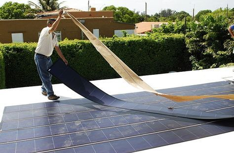 thin film solar - As easy as peel and stick. (And then attach connectors.) Efficiency is improved if film is slanted toward sun. Final installation and layout of Uni-Solar Ovonic's thin Film Flexible Solar PV panels. Image: Fieldsken Ken Fields. Video of a panel lying flat on a deck: youtube.com #rvlayout