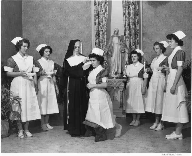 Pining on nurse's caps. It was still a religious sort of ceremony when I graduated from a public school program in 1970.  None of us even thought of this as prejudicial at that time. Change is good