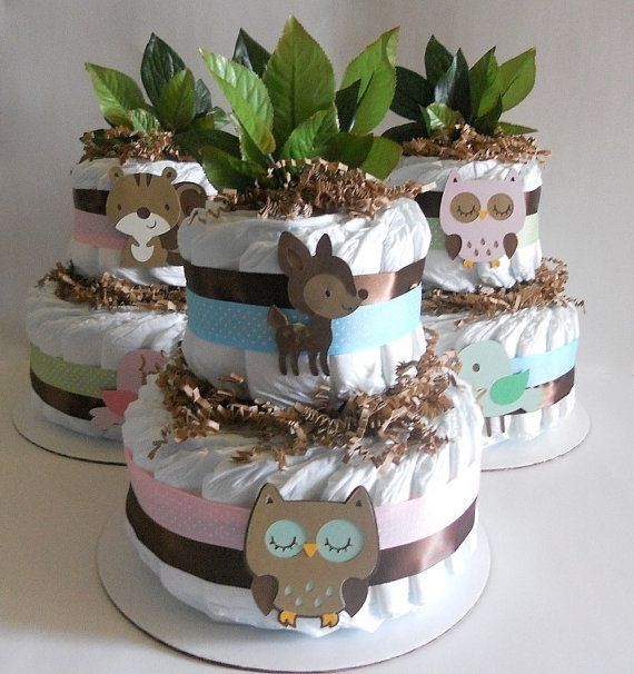 Woodland Diaper Cake by Diaper Cake Boutique    - 35 Pampers size 1  - Ribbons  - Paper Shred  - Two Animal Die Cuts  - Leaves  displayed on a 10 in. cake round