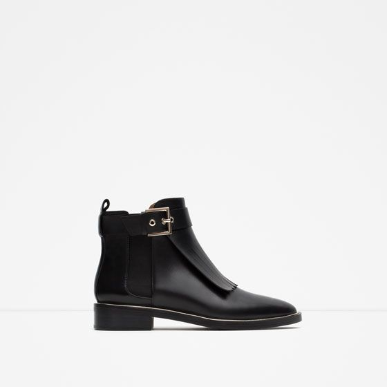 LEATHER ANKLE BOOT WITH FRINGES