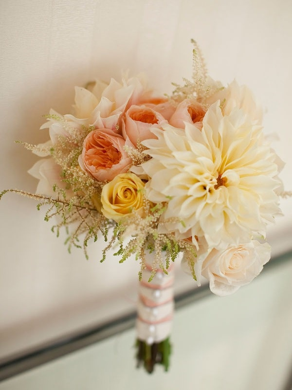 Maybe a little too yellow but I do like the blushy garden roses, the big blush dahlias and the rustic astilbe which is a baby's breath-like filler.