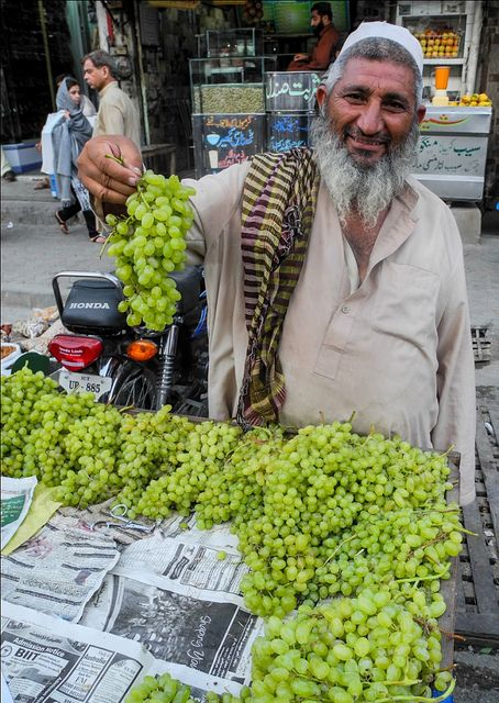 Grape seller with a great personality (photographer's note), Islamabad, Pakistan.