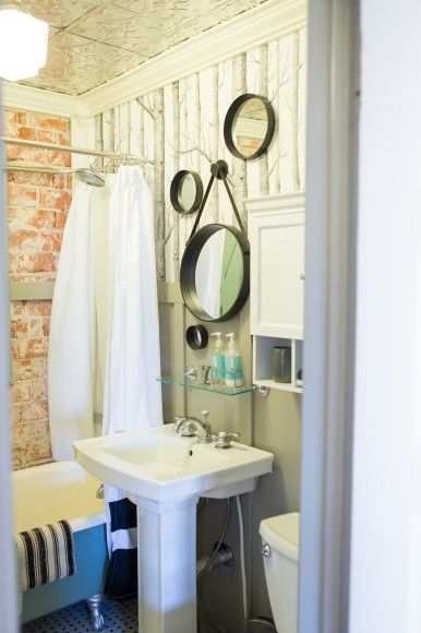 THIS IS MY FAVOURITE SO FAR. I know it probably isn't what you're into, but I love the quirky aspect of it and think the multiple circular mirrors are adorable. It also looks like a weeny bathroom, just like ours.
