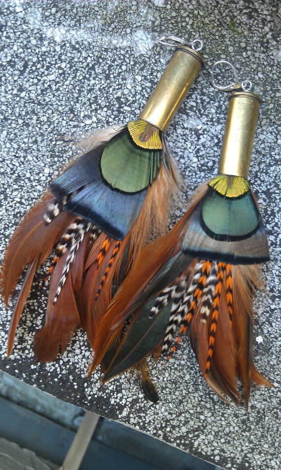 Bullet Casing Feather Earrings - Natural rooster feathers, grizzly rooster feathers, and peacock feathers - medium length. $27.00, via Etsy.