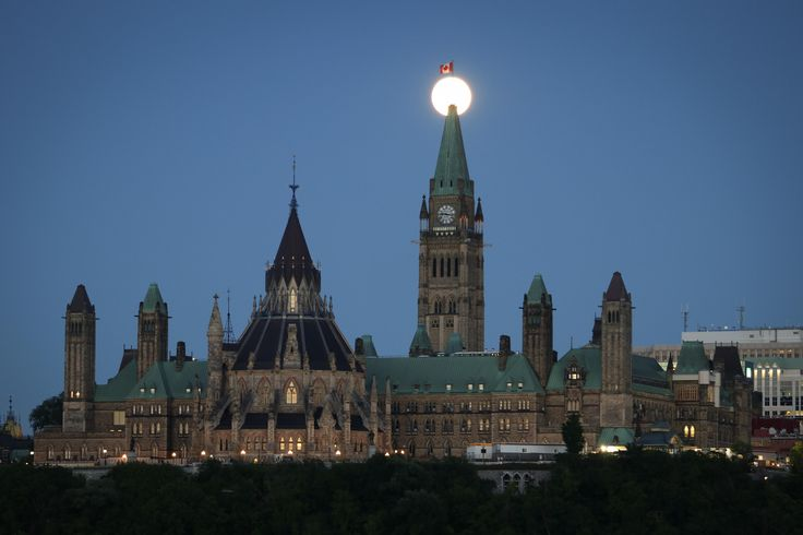 Parliament of Canada in Ottawa earlier tonight. The moon cooperated. [OC] [5772x3848]