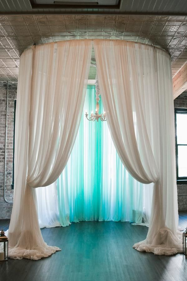 Draped ceremony backdrop for an ocean themed wedding.