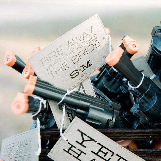 What a cute ideas, give guests pop guns to shoot during off during the kiss. So creative! Photo by Q Weddings
