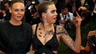 Actress Cara Delevingne gestures next to designer Stella McCartney #honesty