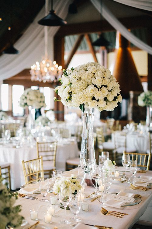 High, white rose centerpieces   @docuvitae   Brides.com