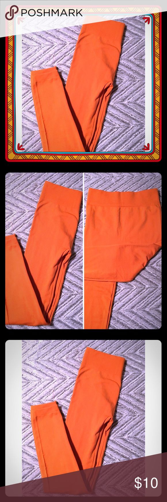 "NWOT Orange Leggings Size Small/Medium Very cute brand new without tags quilted leggings  Bright orange color  Machine Washable  Approximate Measurements  Small/medium stretchable  Rise 10"" Inseam 24"" Pants Leggings"