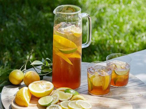 I make this spiked sweet tea in pitchers or big Ball jars. The type of tea you use is up to you; choose your favorite. Then add a mild bourbon.
