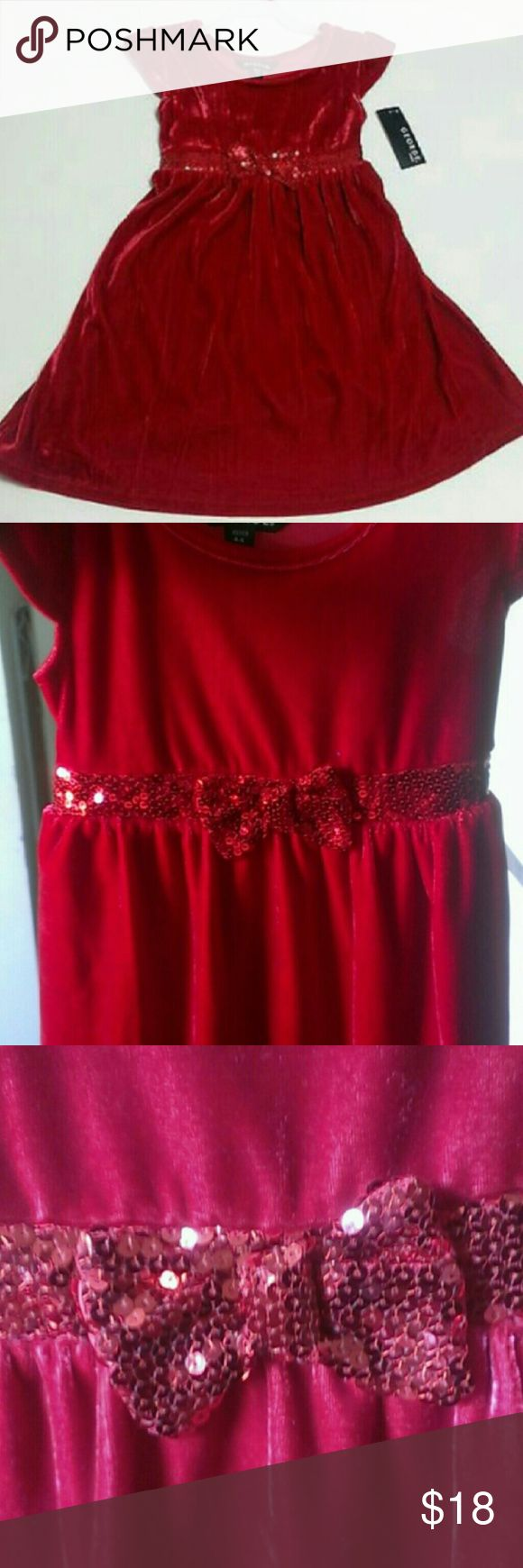 Girls Red Velour Dress With Sequin Bow This cute girls dress is a beautiful red soft velour with a sequin band around the waist and a sequin bow.  This dress would be great for any special occasion church or the daddy-daughter dance.  There are 2 different sizes available in this color and style. Extra small 4-5 Small 6-6x  These are all brand new with tags.  My home is smoke free and pet free.  I am a very fast shipper.  Be sure to check out the other items in my closet to bundle for your…