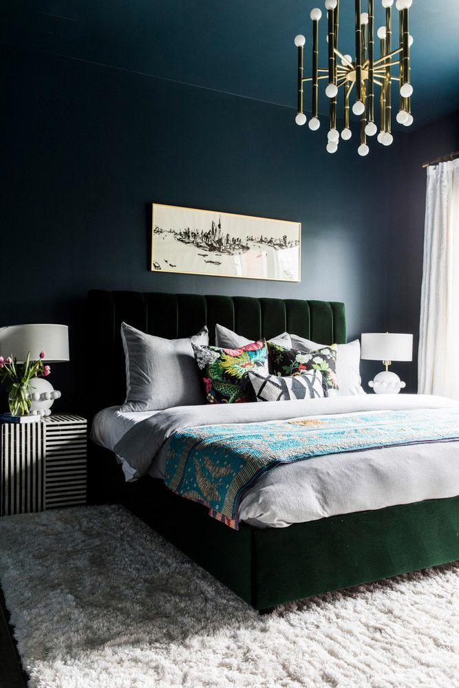 dramatic moody bedroom with deep navy walls