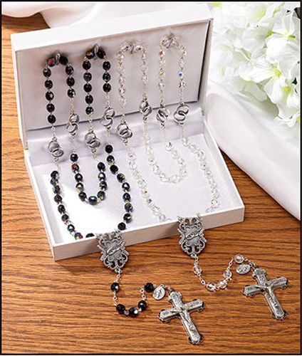Interlocked wedding bands for the Our Father beads! Crystal for the bride, jet black beads for the groom. #CatholicWedding gift #rosary set.