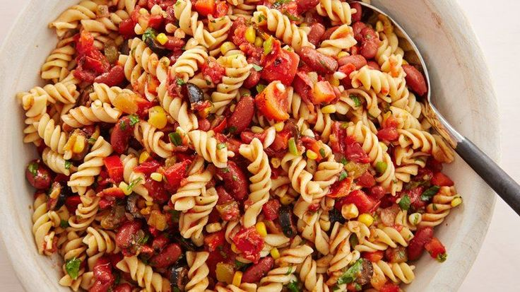 A delicious Mexican-style pasta salad that is thrown together in minutes! Served warm or at room temperature, it's full of color and flavor.