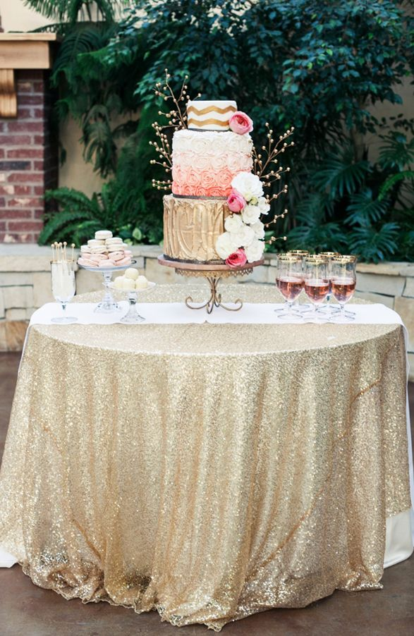 nice and simple, with main eye catcher being a shiny tablecloth and some levels - gold and pink cake table ideas