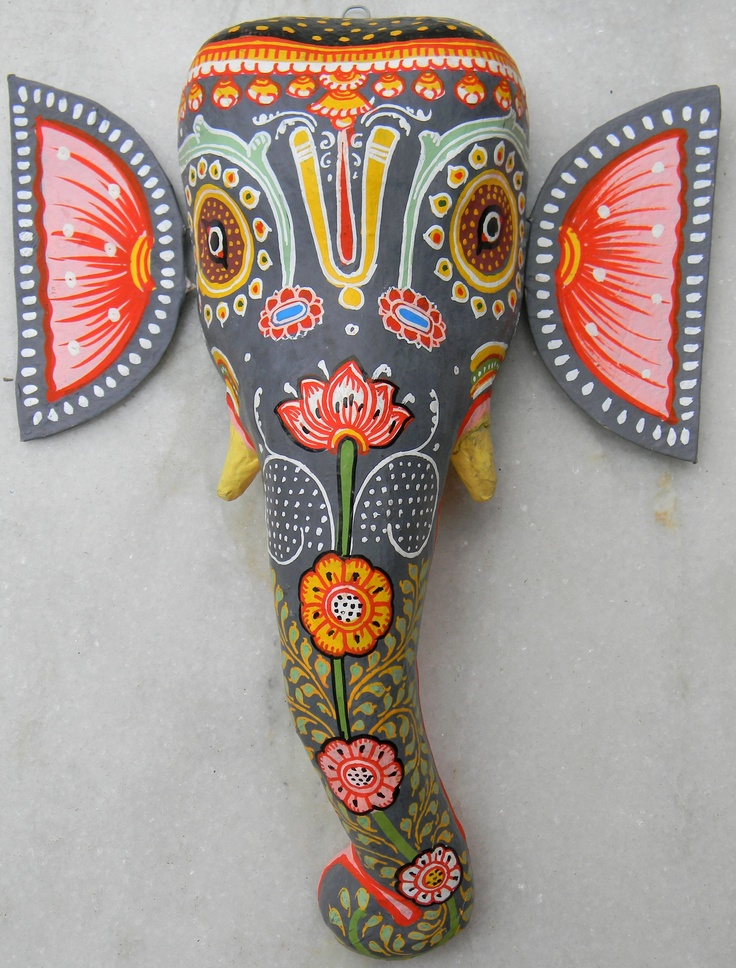 This vibrant colored mask of the Elephant God is made of papier mache and intricately hand painted by artisans from Orissa (east India). A vibrant addition to any living room wall. Since Lord Ganesh signifies an auspicious beginning to things, this mask is an apt gift for events such as wedding or housewarming. http://www.giftpiper.com/Products/GiftPiper-Curios--Wall-hangings/GiftPiper/Ganesh-Papier-Mache-Mask--black/pid-968664.aspx