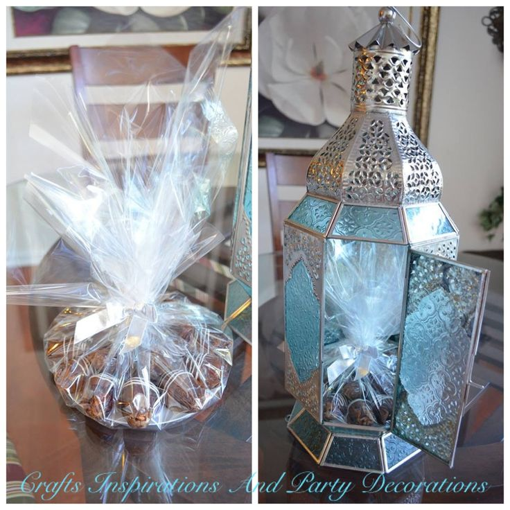 Wouldn't you love to have a gift like the one I made?! Almond stuffed dates dipped in milk chocolate and drizzled with white chocolate then wrapped in a cellophane nylon and placed inside a lantern!!