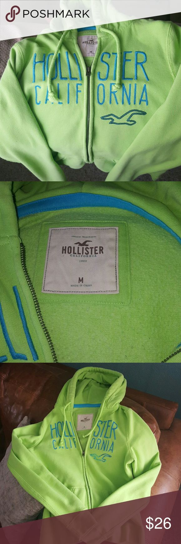 Hollister Co. Zip-up Hoodie Beautiful bright green women's zip up! A cozy and comfortable size Medium, worn a handful of times.  **Has a little white paint spot on the back towards bottom of shirt. But besides that, it is in like-new condition! :) From a smoke-free home Hollister Tops Sweatshirts & Hoodies