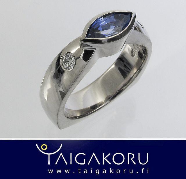 White gold ring with blue sapphire. Valkokultainen timanttisormus sinisellä safiirilla. www.taigakoru.fi