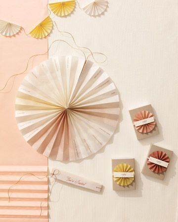 This pleated invitation is inspired by the fashionable folds in skirts. The rice-paper cards arrive as modest little rectangular shapes that unfurl into color-blocked rosettes when untied.