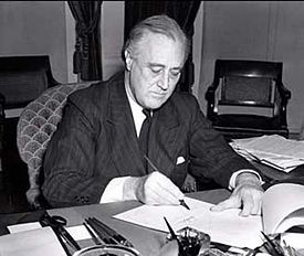 President Franklin D. Roosevelt signs the Lend-Lease bill to give aid to Britain and China (1941)