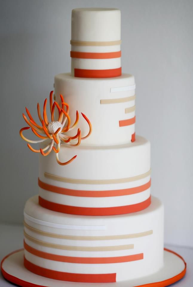 Stripes in orange for this four tier wedding cake.  Love the spider mum.  Beautiful stripe pattern.
