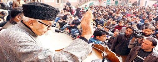 NC patron Farooq Abdullah addressing party workers during youth convention at its headquarters in Srinagar on Wednesday.  	Excelsior/Shakeel