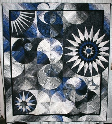 """""""Dark side of the moon"""" displayed at a California quilt show. Great way to mix circle quilt squares."""