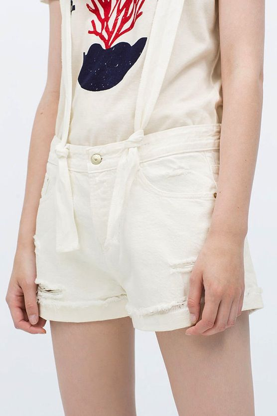 Overall Short In White With Rips And Rolled Hem 01469 Price: US$ 19.00 + Free Shipping #overallshorts #whiteoverall #rippedoverall