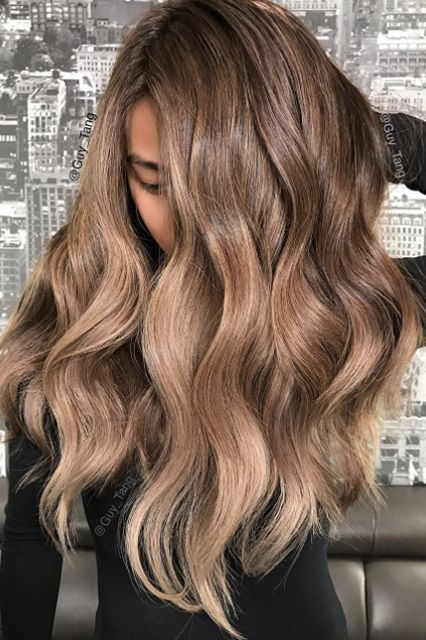 "You Can Now Get The Coolest Hair Color In L.A. — Wherever You Live #refinery29  What to ask for: Rose-gold ombré  What a difference a base makes. Tang used #Mydentity Rose Gold for this look too, but instead layered it over the model's brown ombré hair for a more subdued look.   ""This allowed the lighter pieces to get that rose gold feel, without looking too overdone,"" says Tang. ""It's wearable."""