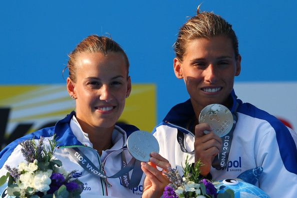Silver medallists Tania Cagnotto and Francesca Dallape pose with their medals and the offical mascot XOP after the Women's 3m Springboard Synchronised Diving final on day one of the 15th FINA World Championships at Piscina Municipal de Montjuic on July 20, 2013 in Barcelona, Spain.