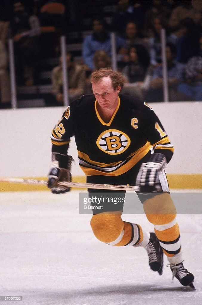 Canadian professional hockey player Wayne Cashman, right wing for the Boston Bruins, skates on the ice during a road game, 1970s.