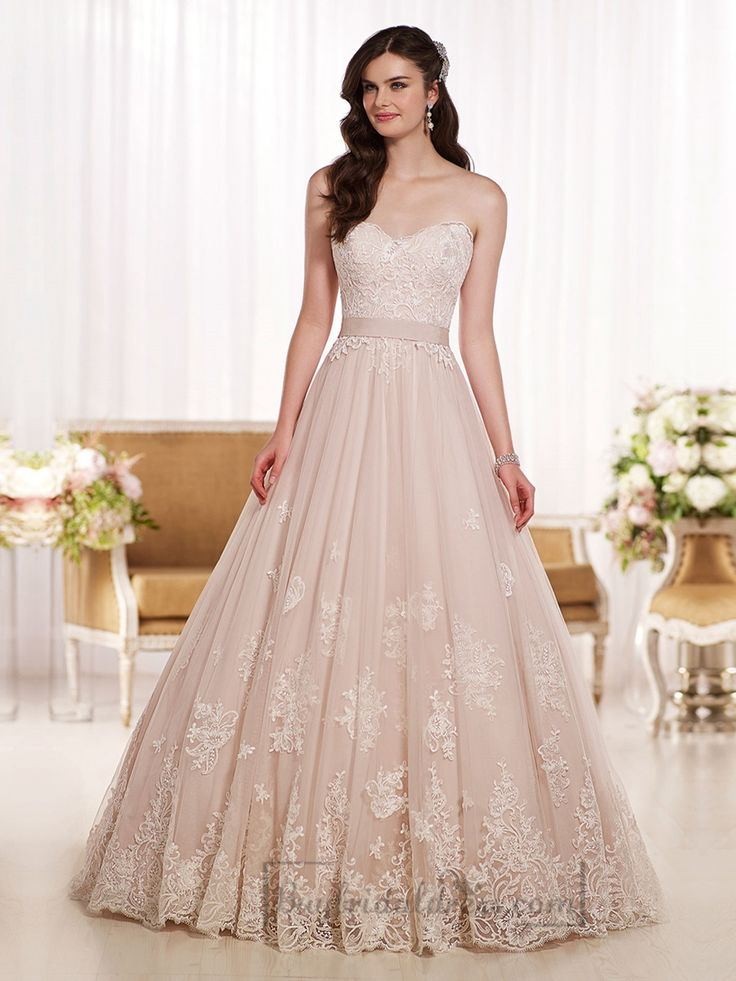 This gorgeous Wedding Dress gathers at the natural waist and then softly flows full into a romantic skirt and train. This wedding gown's ravishing sweetheart bodice features elegant Lace detailing that picks up again at the hem. The back zips up under crystal buttons.