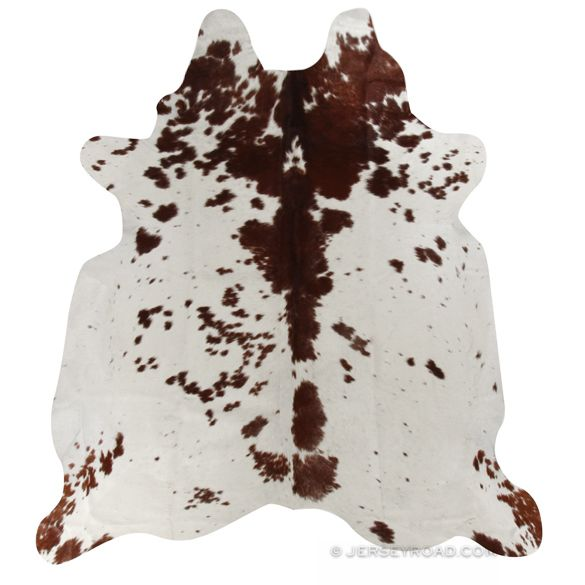 chocolate and white cowhide rug