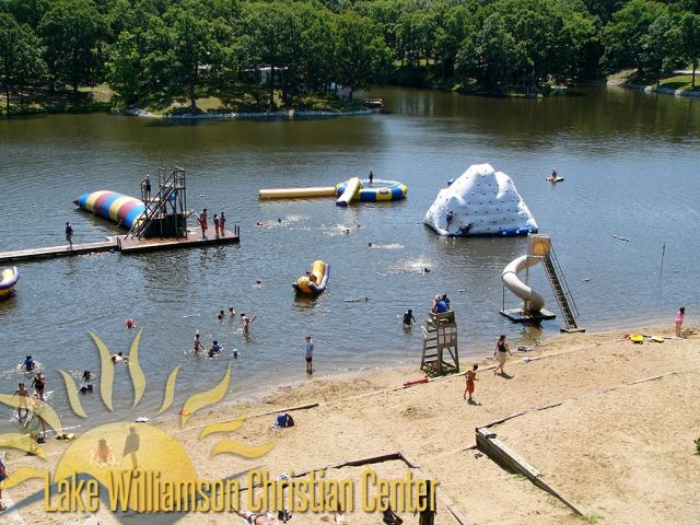 The beachfront at Lake Williamson, complete with iceberg, water trampoline, zip line, Plunge water slide and the famous Blob!