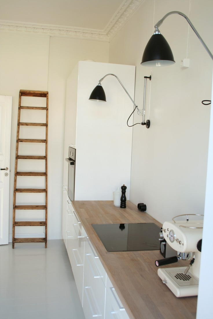 My kitchen from Ikea with lamps from Bestlite and white handles from the danish store Kvik
