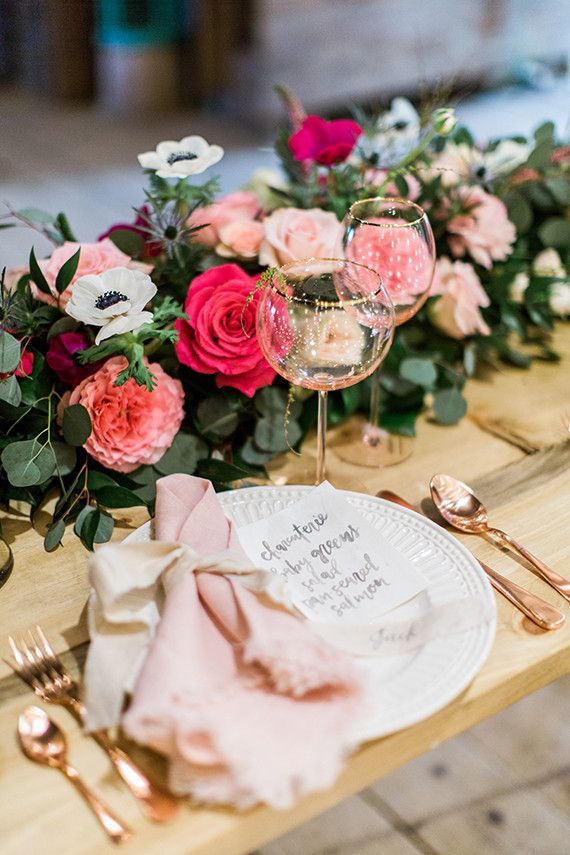 The gold rimmed glasses and rose gold cutlery make this table setting amazing!