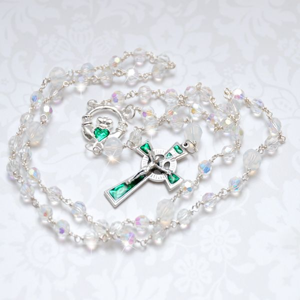 Claddagh Celtic Rosary Beads - crafted with vibrant faceted Swarovski crystals & would make a beautiful gift for special occasions such as Christening, 1st Holy Communion, Confirmation or Marriage. The Hail Mary beads are faceted crystals and the Our Father beads are opal crystals. The centerpiece is an exquisite silver Claddagh with gorgeous emerald green enamel accents. The crucifix is has a Celtic knot design and matching emerald green accents.