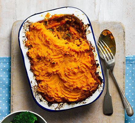 Spiced red lentil dhal is topped with creamy sweet potato mash in these individual vegetarian pies - a cheap weeknight dinner option